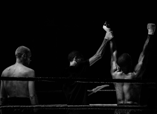 Boxing Referee lifting the arm of the winner