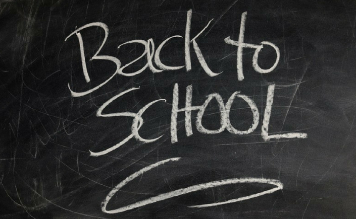 The words Back to School written in white chalk on a blackboard